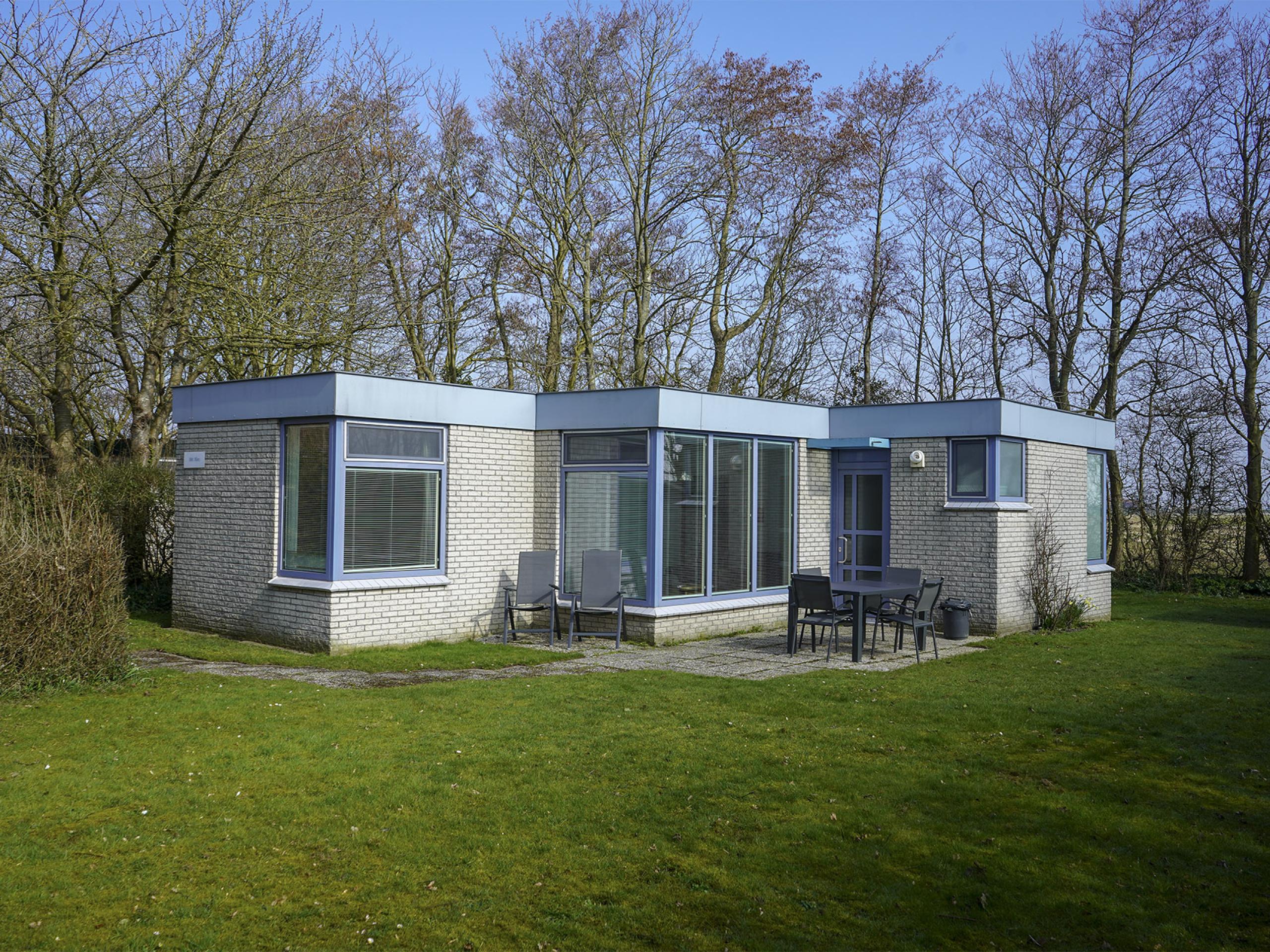 Freistehendes Ferienhaus in einem ruhigen Park in der Nähe von Oosterend