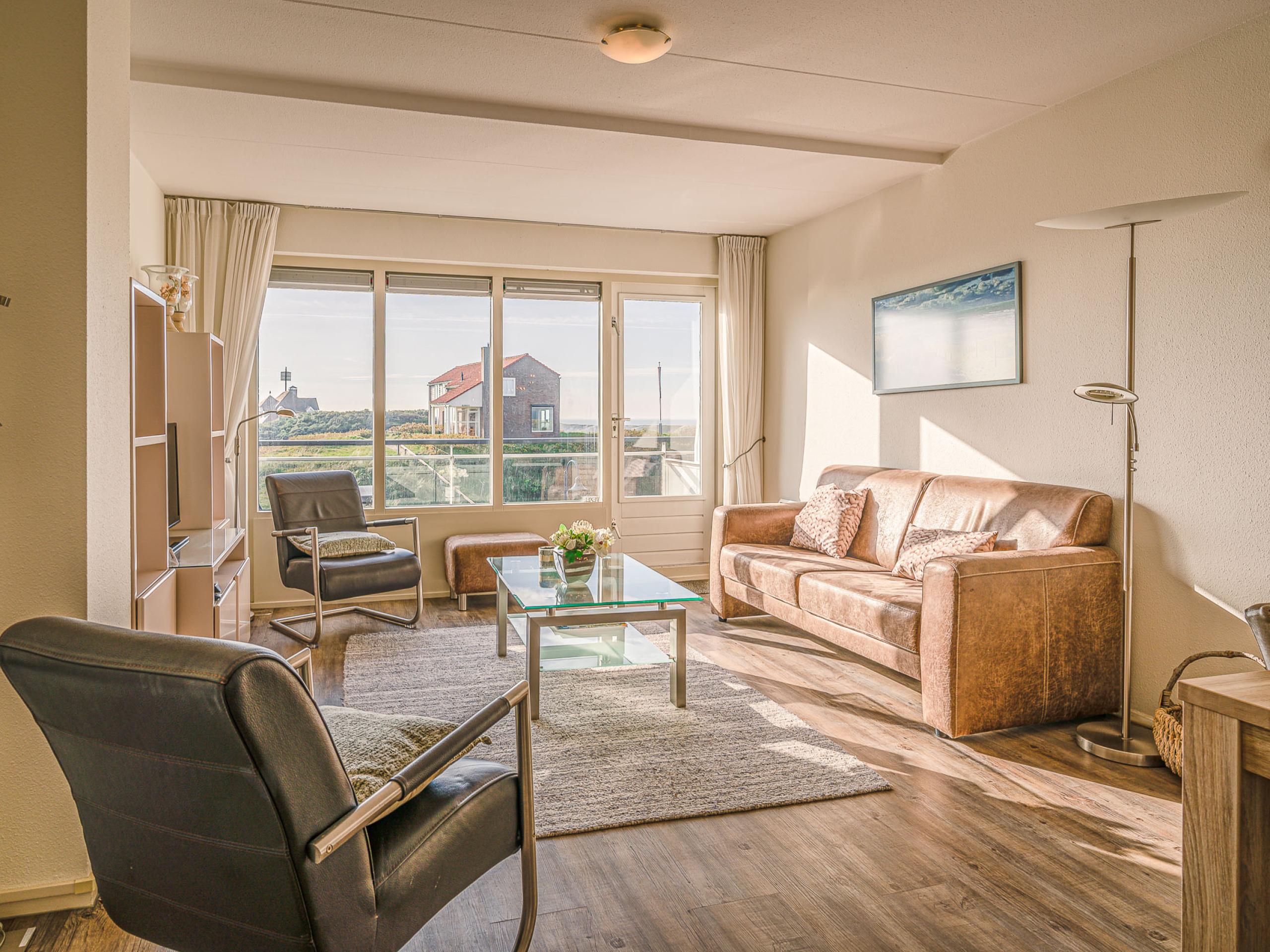 Modern appartement bij De Koog met zicht op duinen en zee