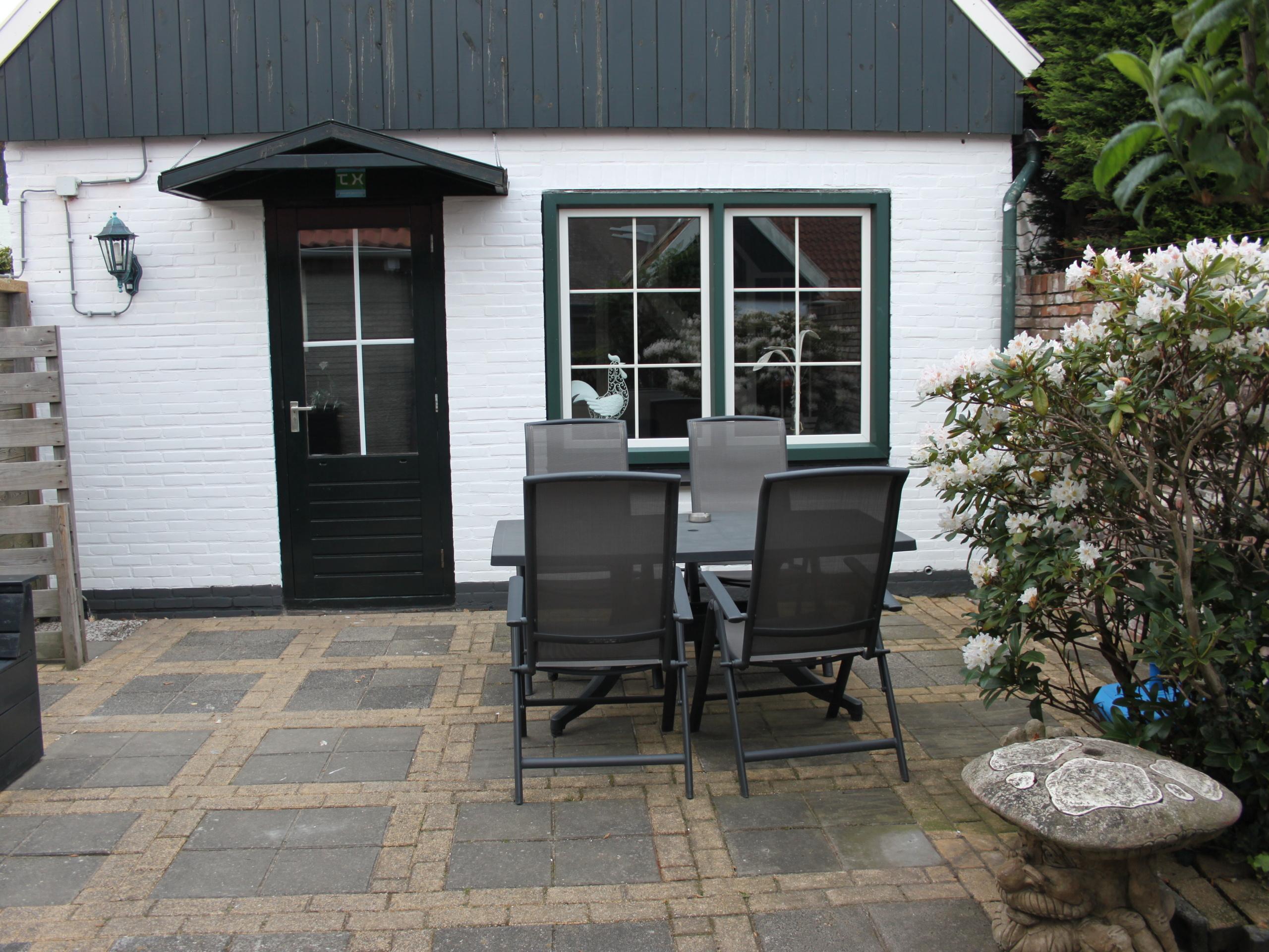Knus vakantiehuis met rustige ligging en zonnige tuin bij het centrum van Den Burg