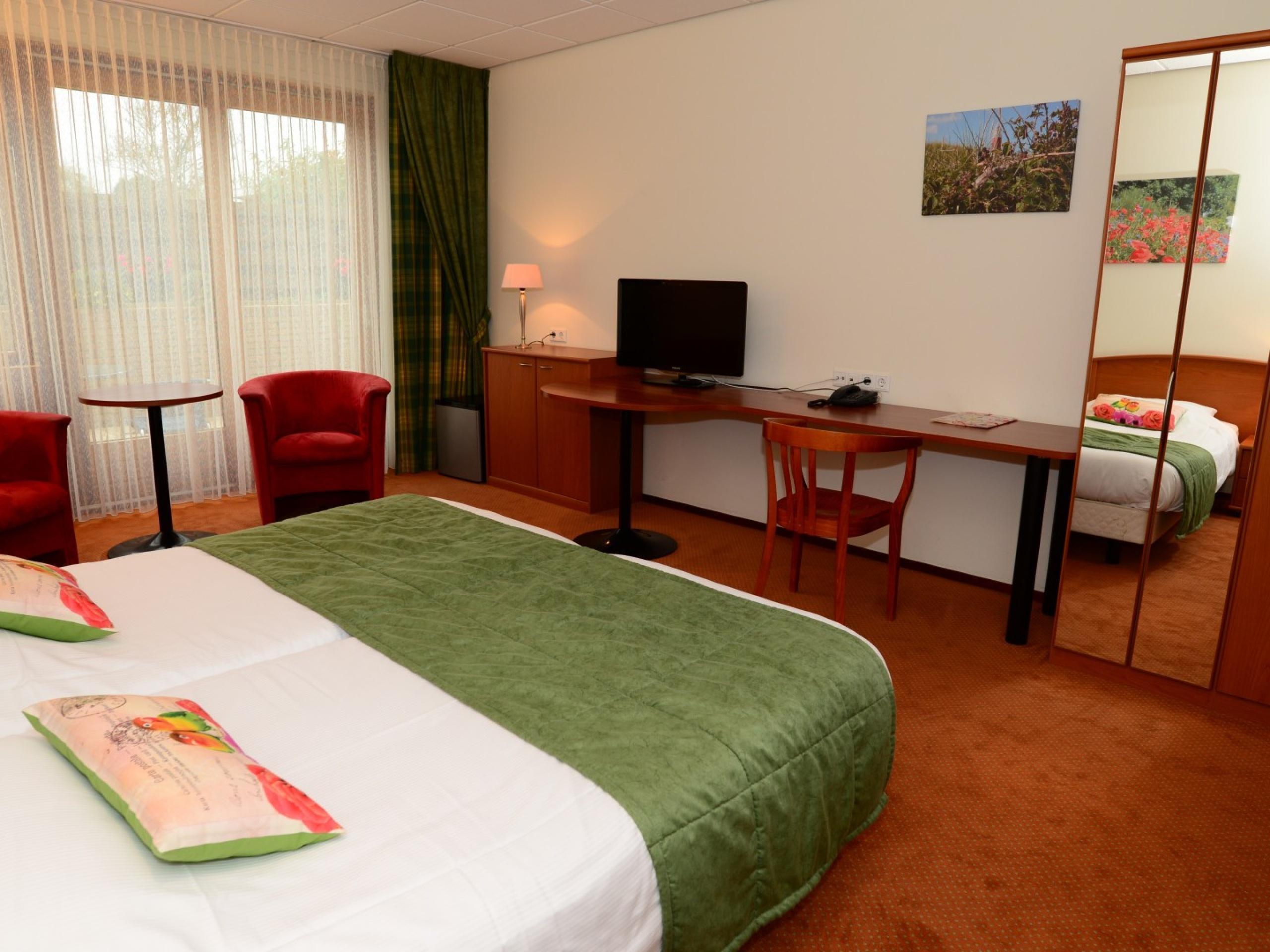 Hotelzimmer in De Koog Innenhofseite mit Terrasse mit Privatsphäre