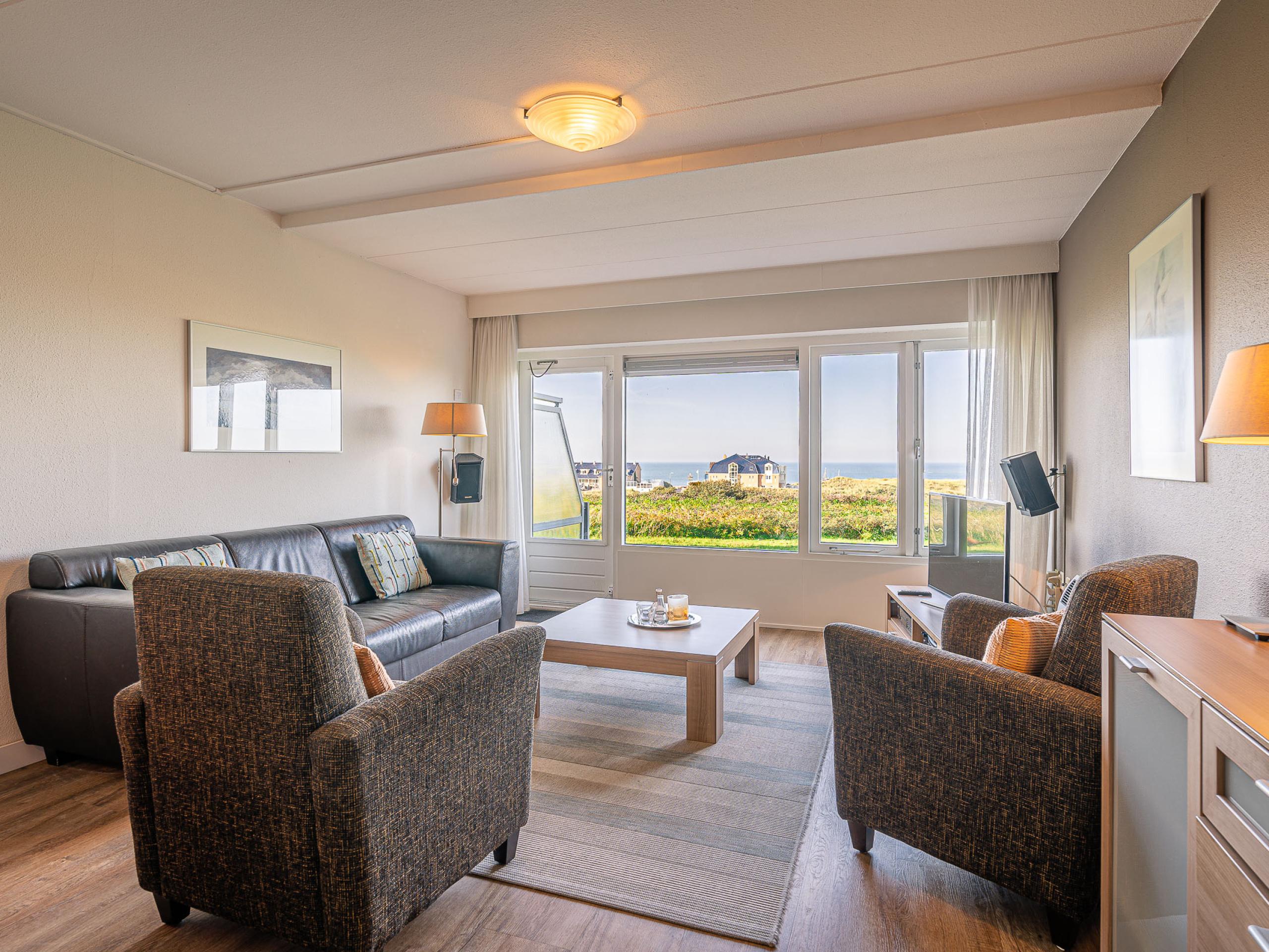 Appartement bei De Koog mit großem sonnigem Balkon mit Meerblick