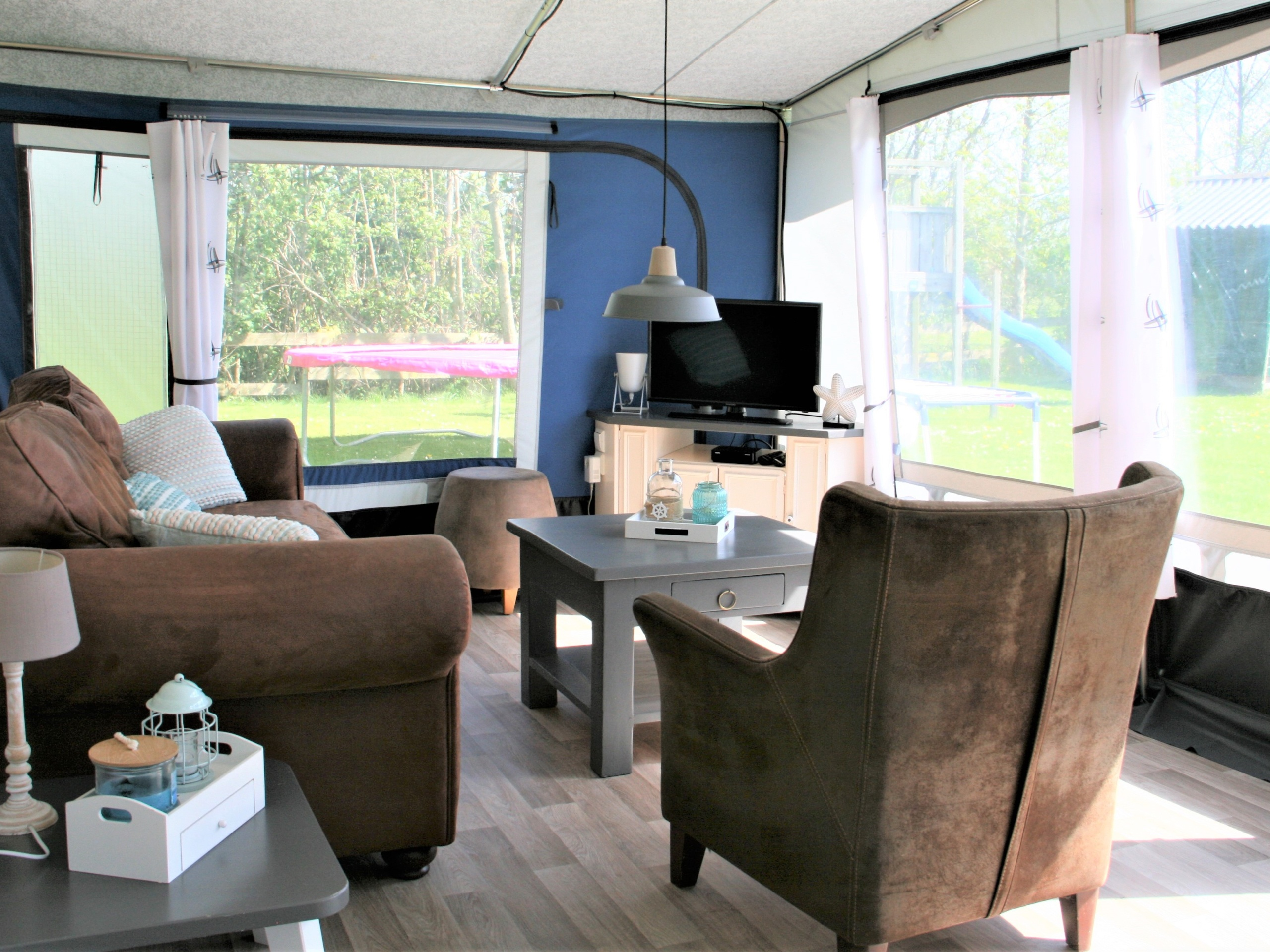 Comfortable touring caravan with private bathroom nicely situated at Den Hoorn