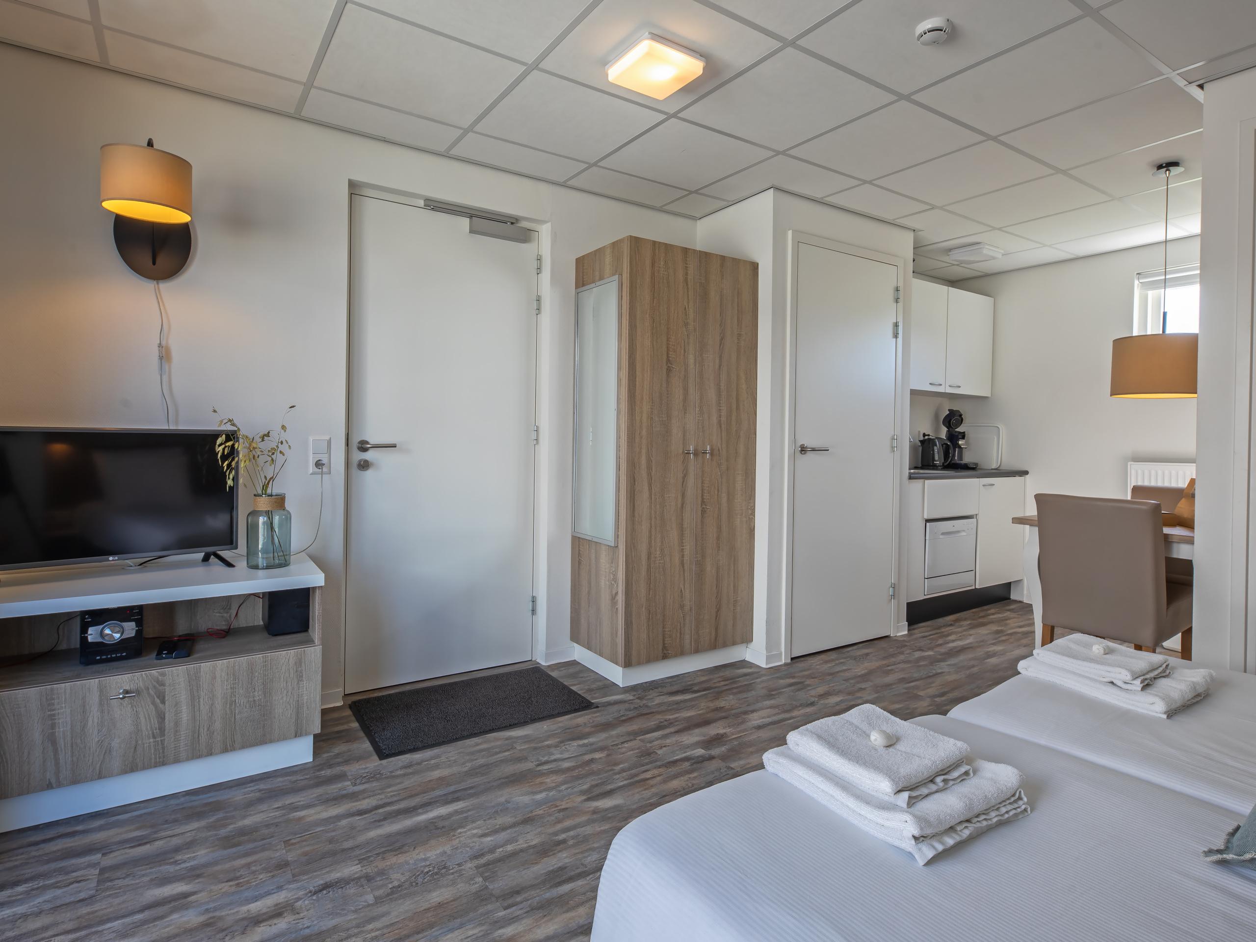 Fijne suite in complex op loopaftand van het strand in De Koog