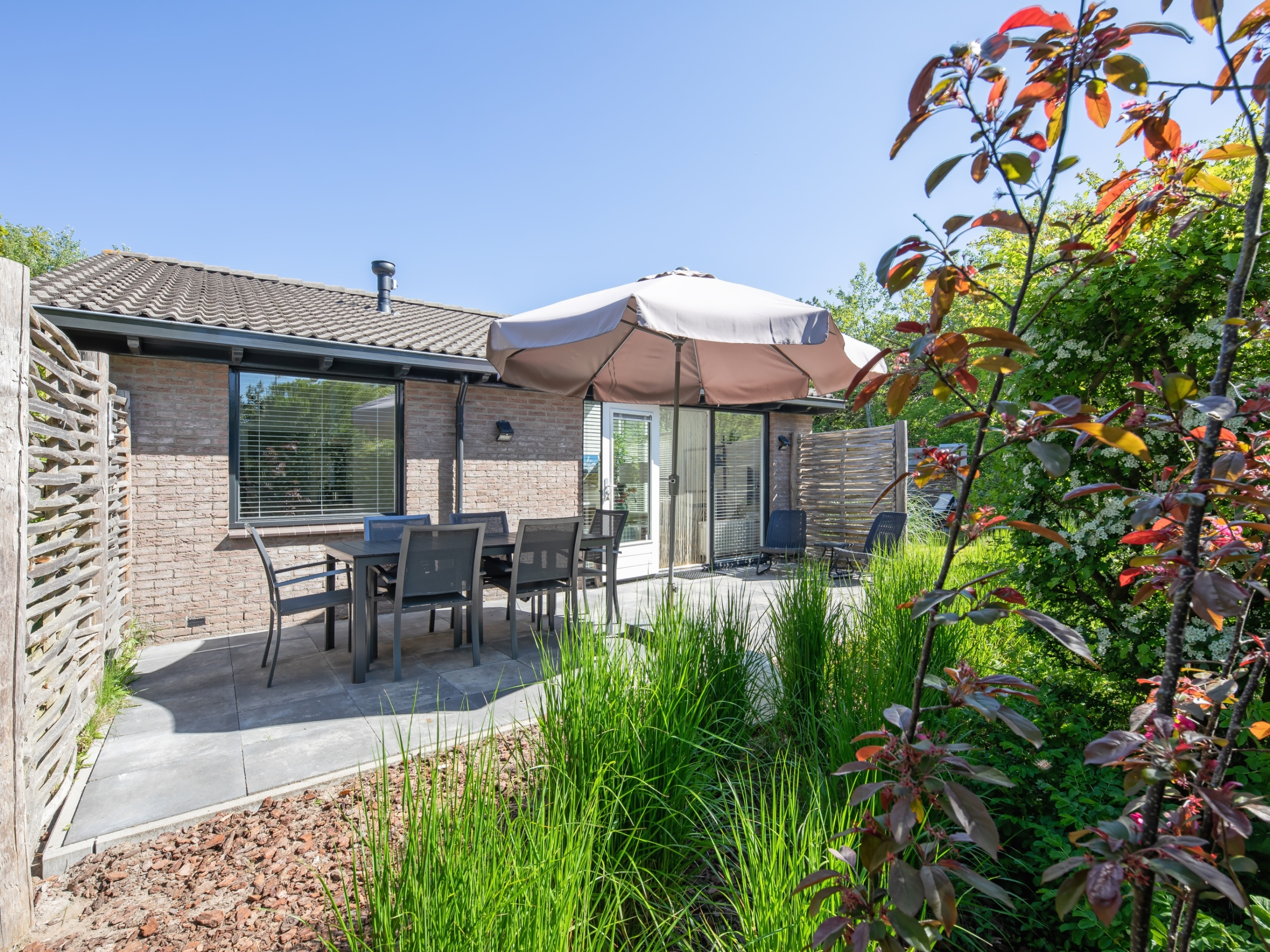 Holiday home in a quiet location on the edge of De Koog on a small park