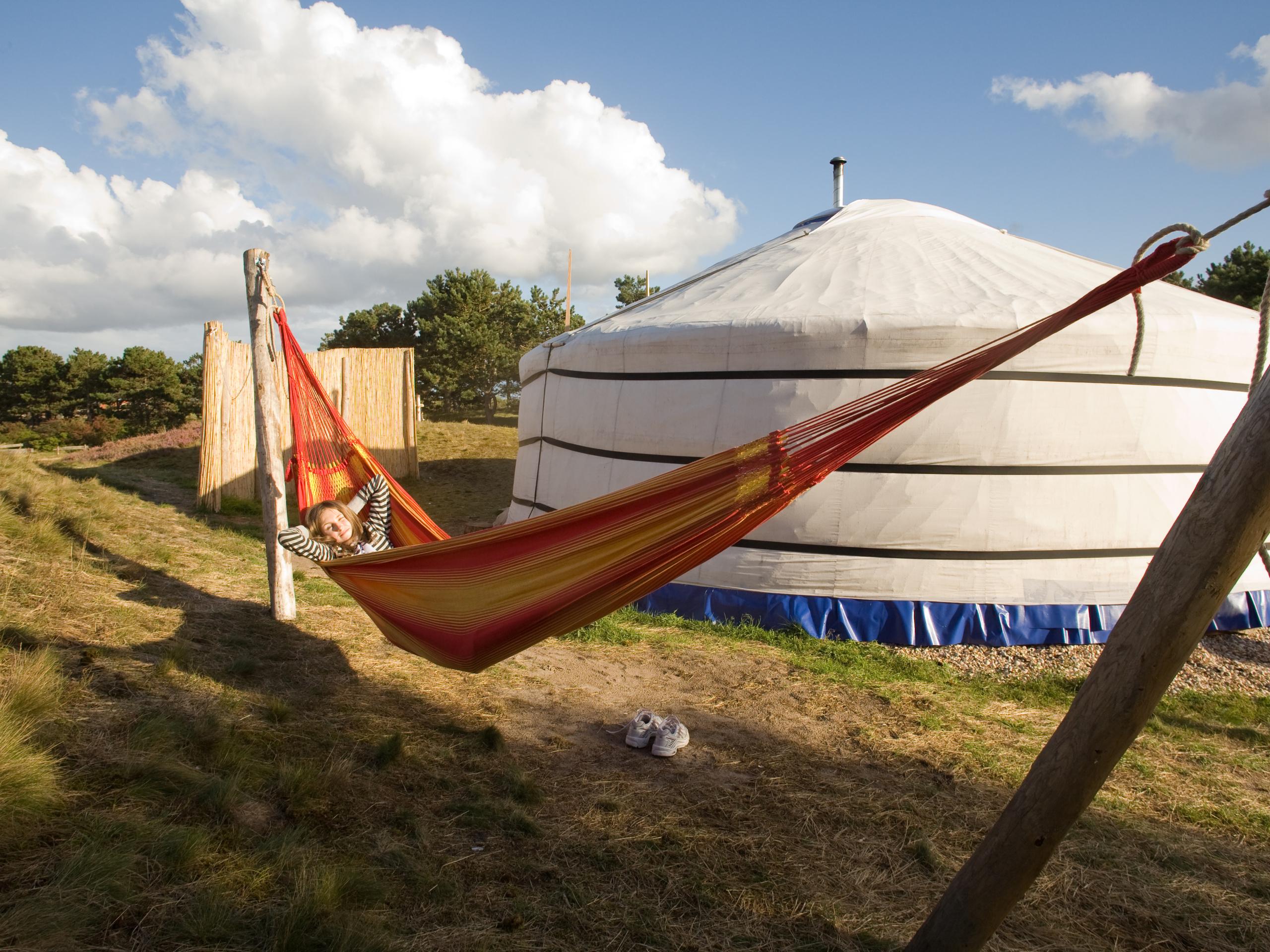 Unwind in a luxurious and charming original yurt in the dunes near Den Hoorn