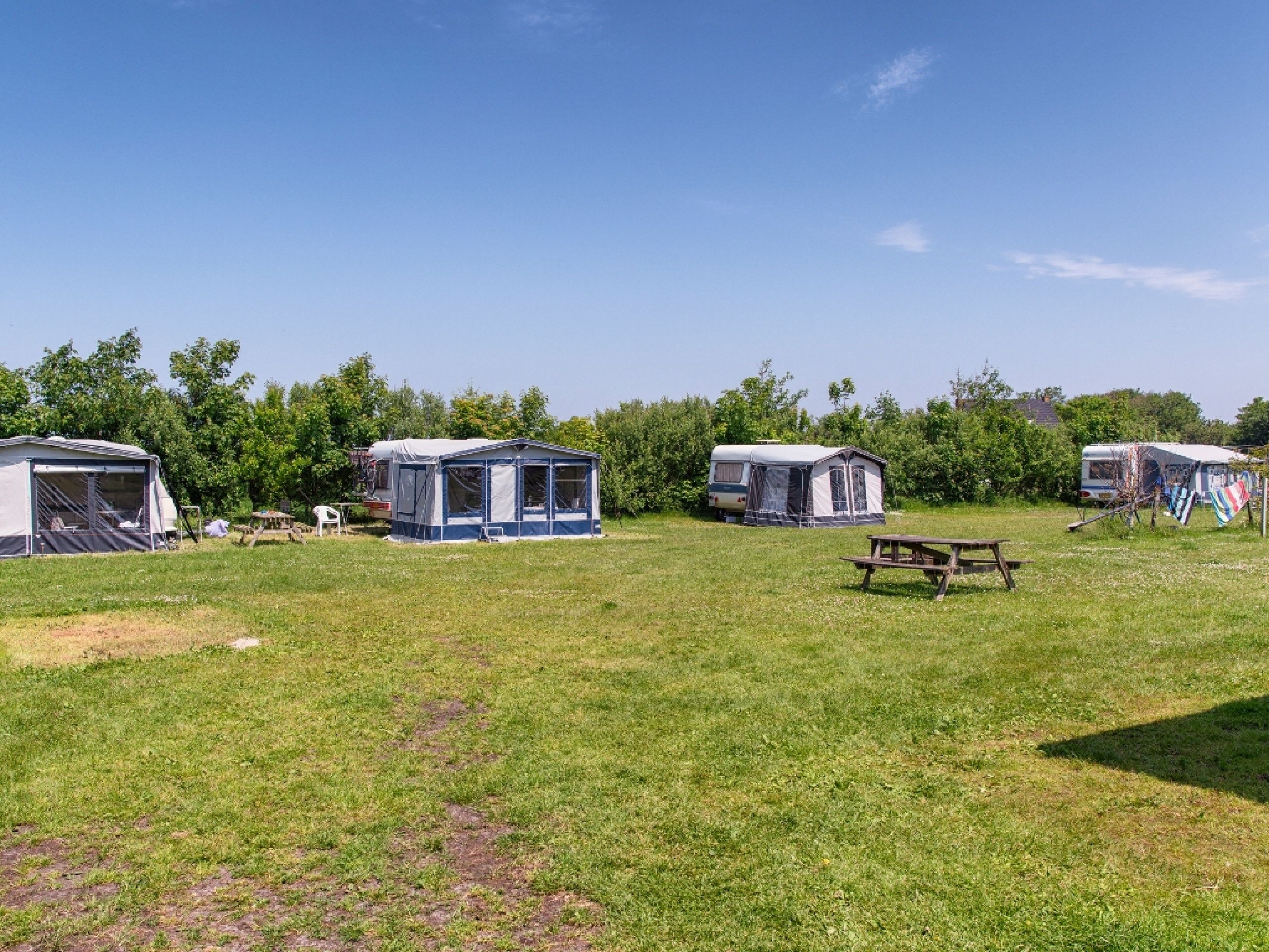 Schöner Camping auf dem Bauernhof mit Dünenblick, nur wenige Gehminuten vom Strand von De Cocksdorp