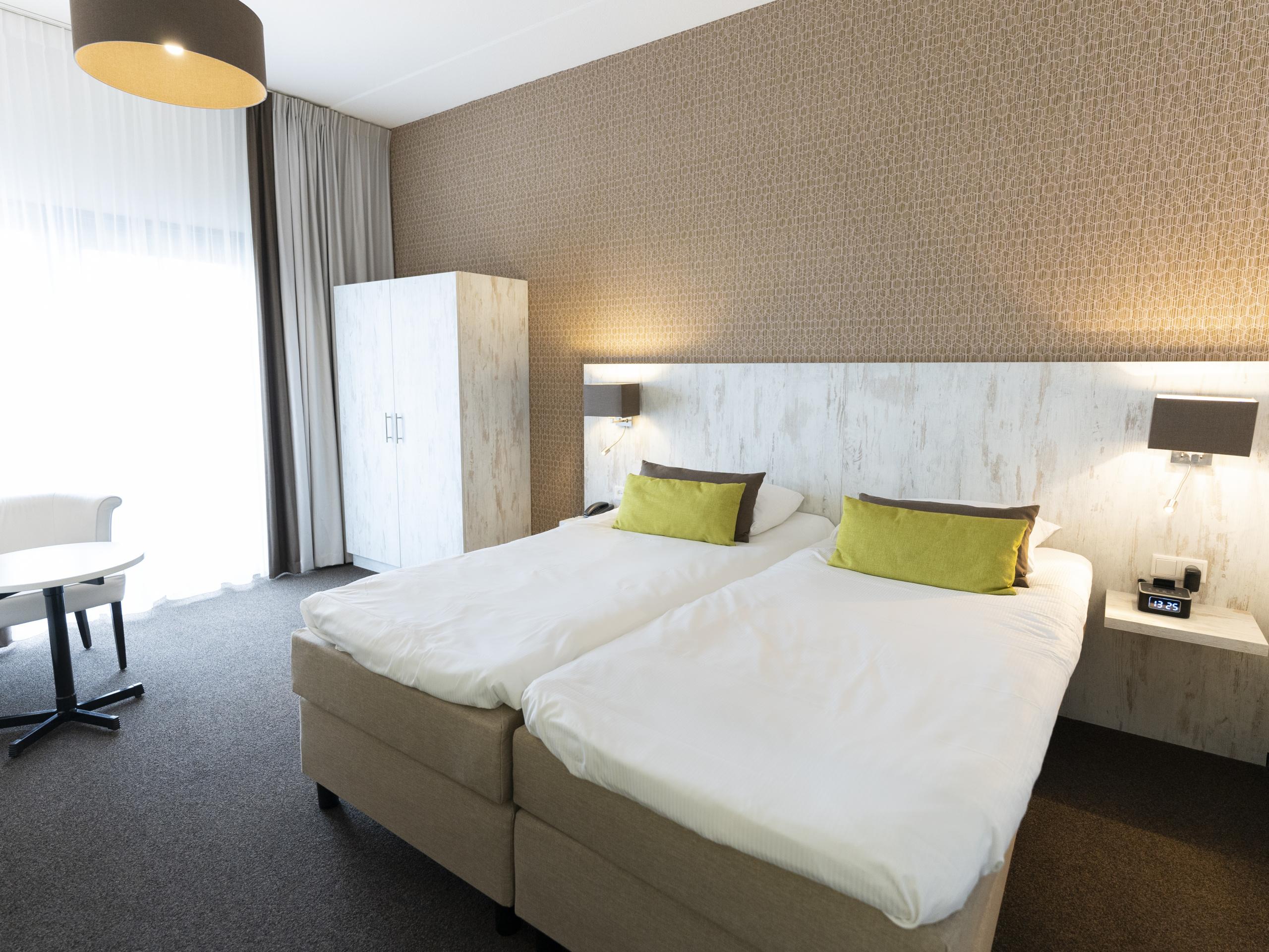 Hotelzimmer mit eigenem Balkon oder Terrasse bei De Koog
