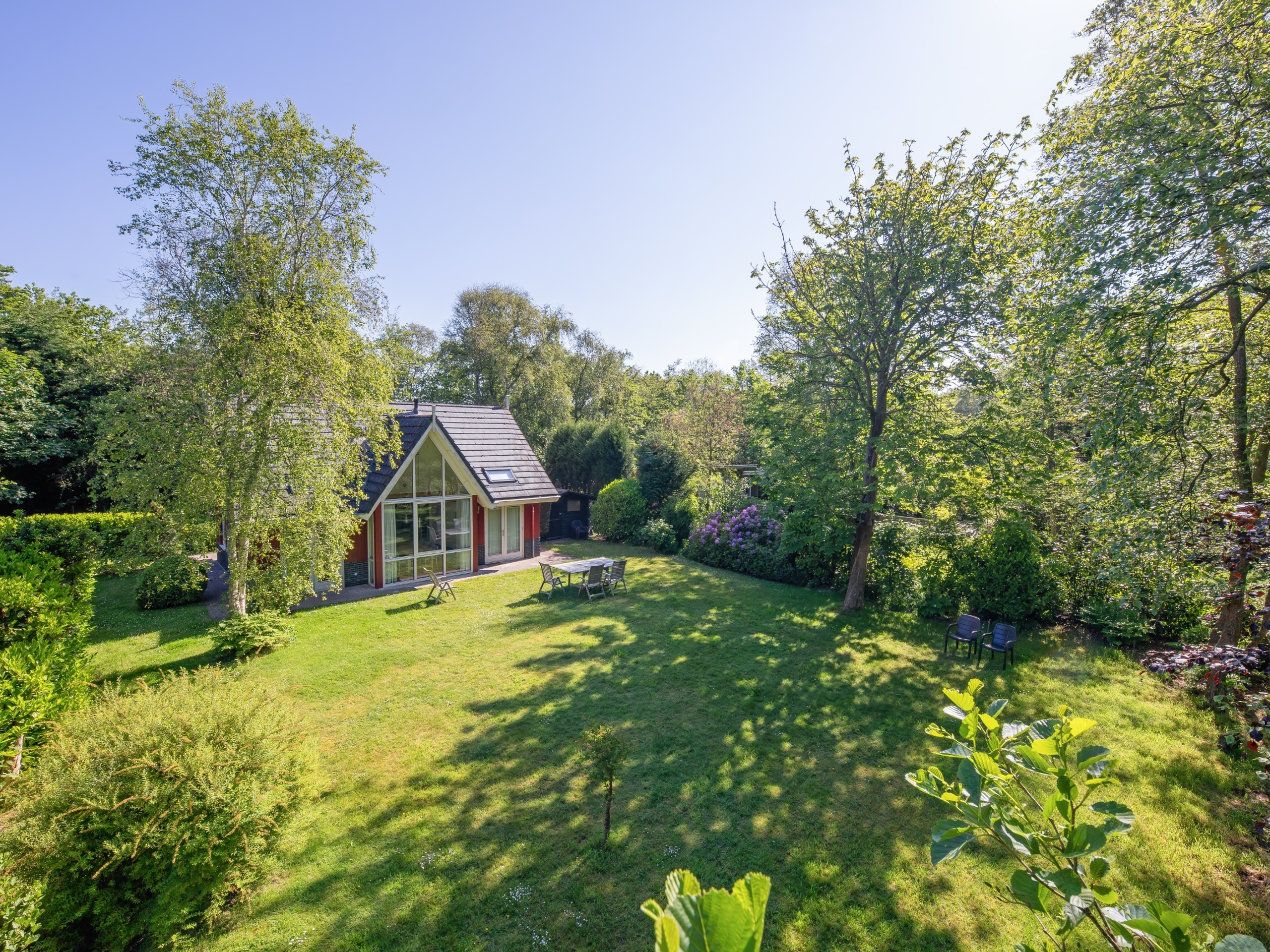 Attractive detached holiday home with lots of privacy on a forest path in the middle of the forest